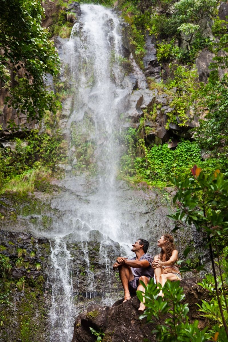 Couple relaxing at a waterfall