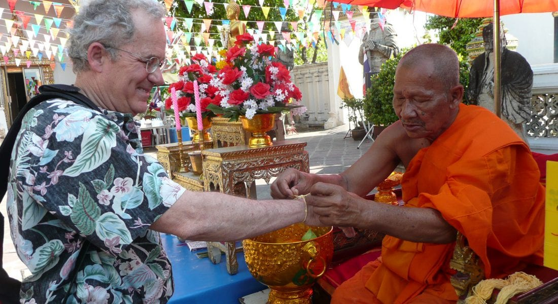 Joseph receiving blessing from Monk in Bangkok