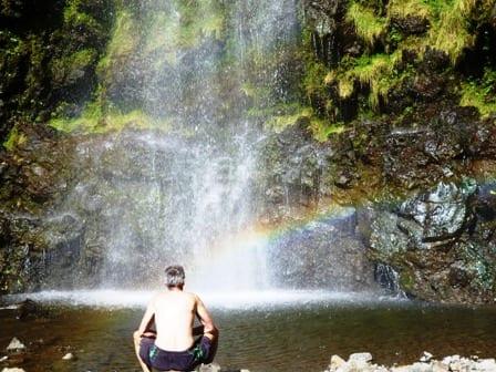 Man at waterfall Hana, Maui
